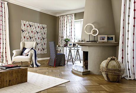 Riviera by JAB - more rope pattern on curtain fabrics. Picture of a living room in German showroom.
