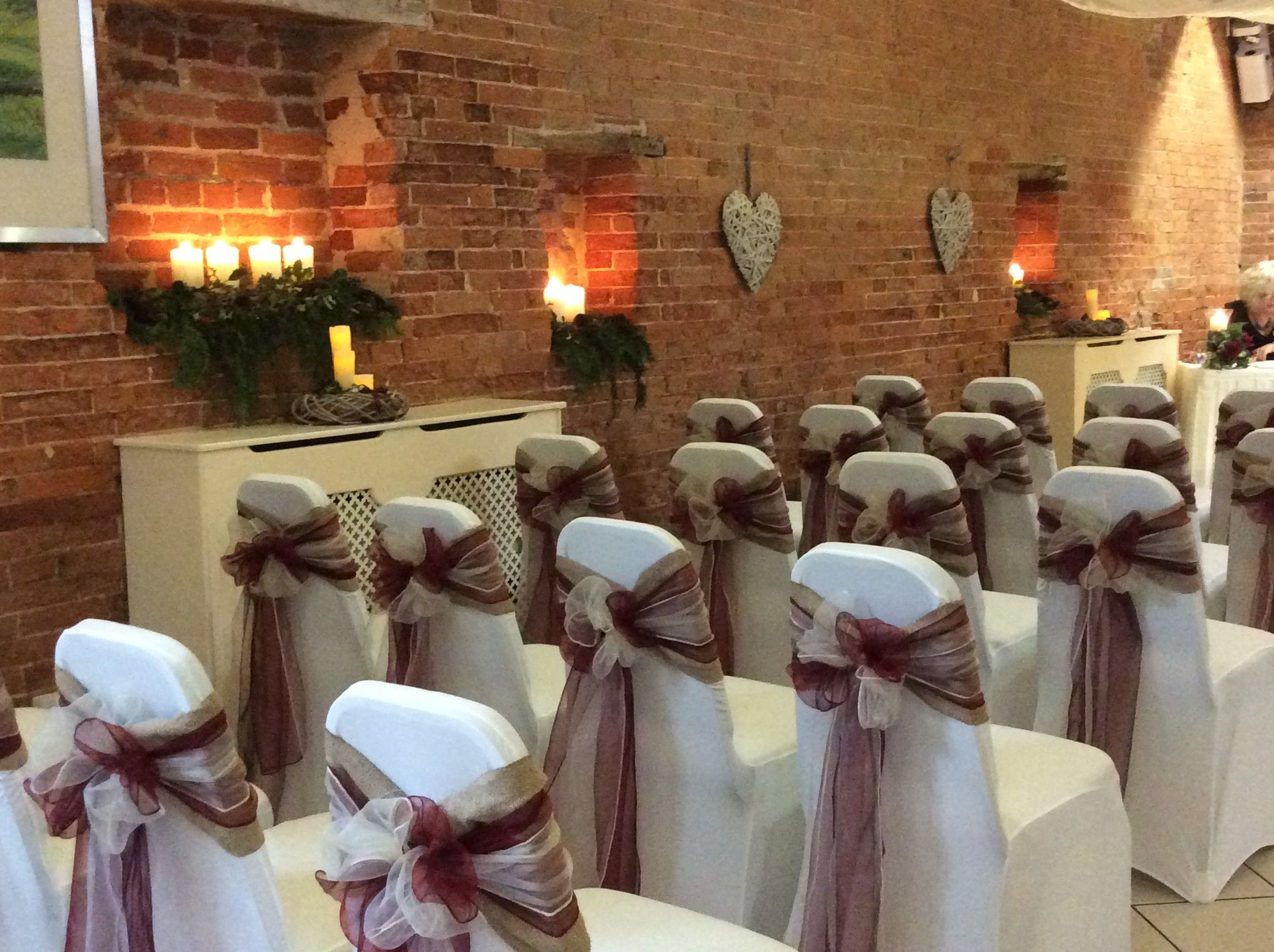 burgundy chair covers wedding reupholster outdoor chairs ivory with a and rosette www beautifulvenuedecor co uk