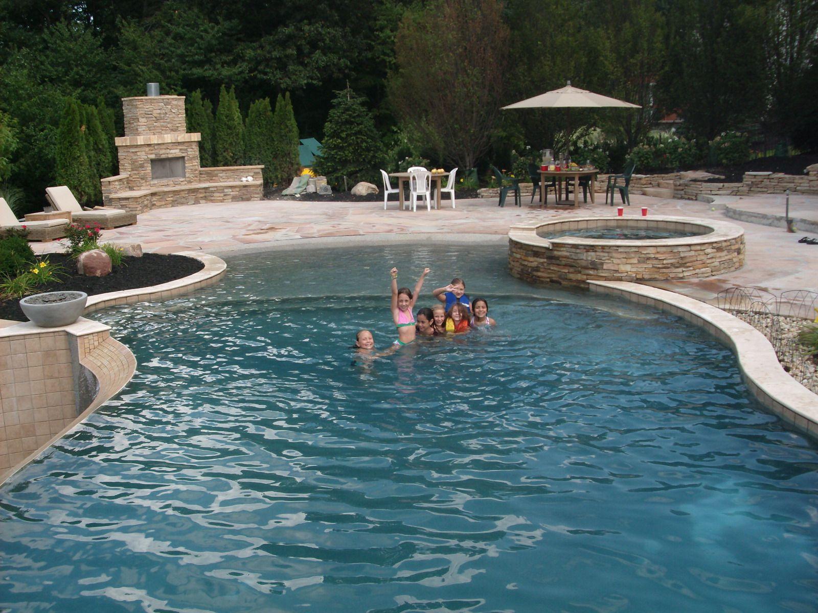 18x46 custom gunite pool spa beach entry negative edge raised beam - Gunite Pool Design Ideas