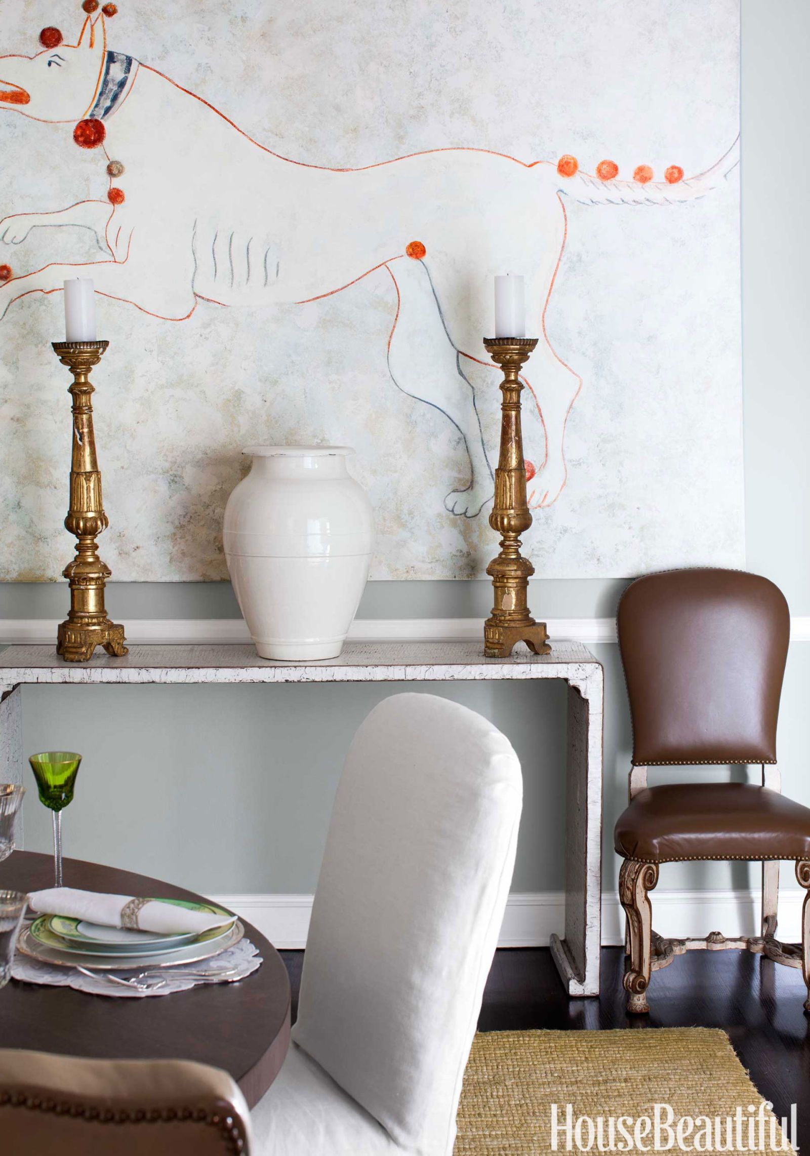 A slim, contemporary console from Mix Furniture doesn't take up a lot of space in the dining room.   - HouseBeautiful.com