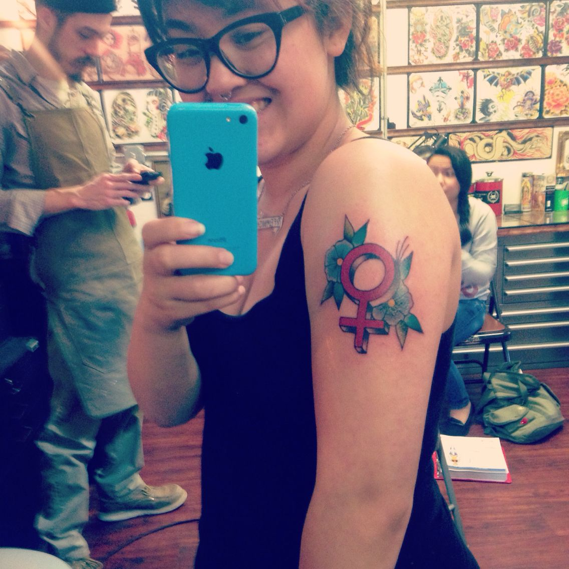 Feminist symbol tattoo on the left forearm illustrative tattoos my feminist tattoo i chose to do a venus symbol and flowers in a traditional buycottarizona Image collections