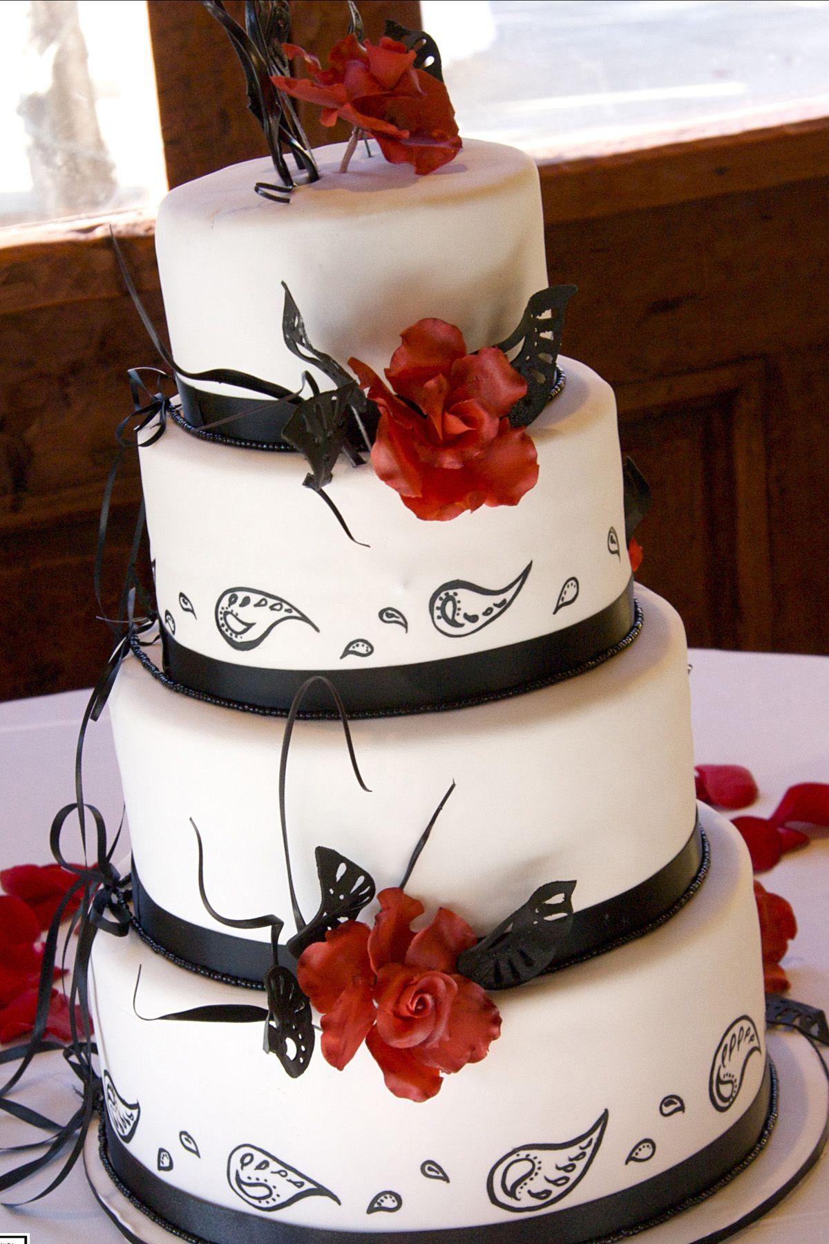 tier white fondant wedding cake with black paisley design
