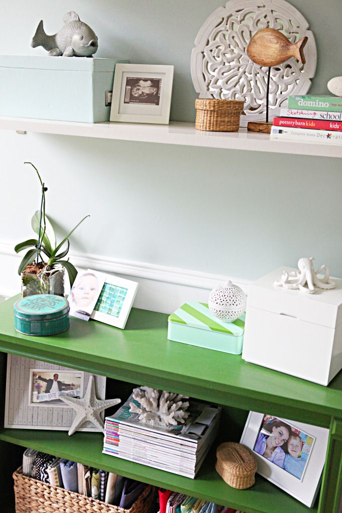 Love the green bookshelf styled with beachy items...just my style :)