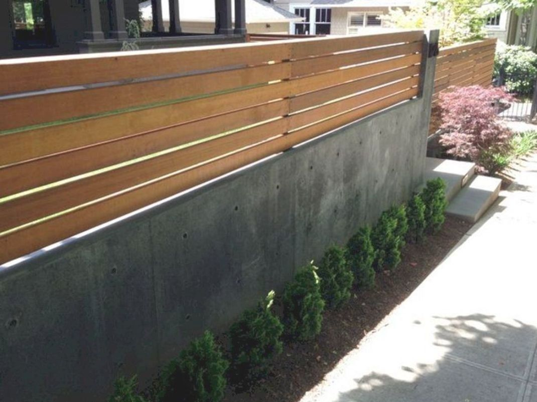 Wood Fence On Top Of Concrete Retaining Wall Wood Fence On Top Of Concrete Reta Modern Design In 2020 Modern Fence Design Fence Design Concrete Retaining Walls