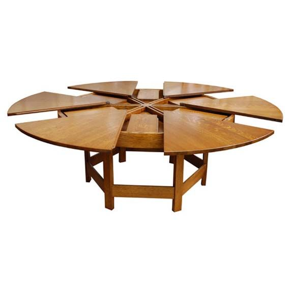 This is a unique dining table, designed with a round shape, which will make  your dining room designs become more attractive.