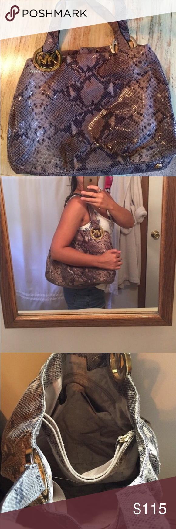 Snake skin Michael Kors bag Good condition Mk bag, lots of space.  small wear mark on strap Michael Kors Bags Shoulder Bags