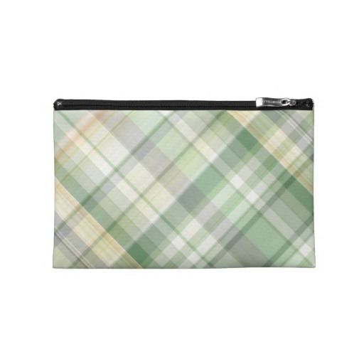 Green plaid pattern travel accessories bag. ~   A digital pattern of random lines in shades of dark and light soft green, pale orange and grey, in diagonal striped checks or tartan.