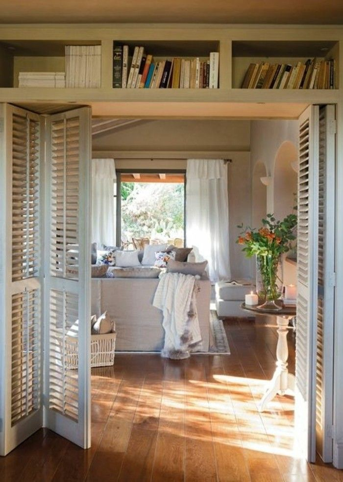 Amazing les portes pliantes design en photos with cloison for Cloison coulissante style atelier