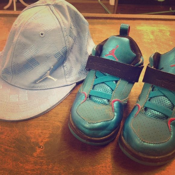 Toddler Jordan's and flat bill hat Toddler 10 Jordan's (strictly play shoes)  and like new Jordan baby blue flat bill hat size price is for both hat and  ...