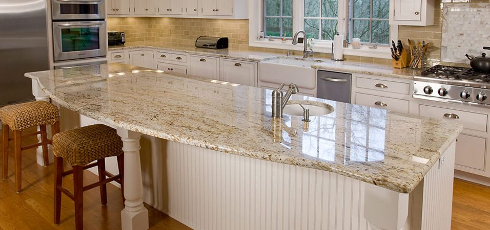 white kitchen cabinets granite countertop and tan walls  Welcome