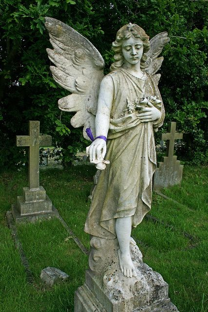 weathered angel statue memorial in cemetery ribbon on wrist flickr photo sharing
