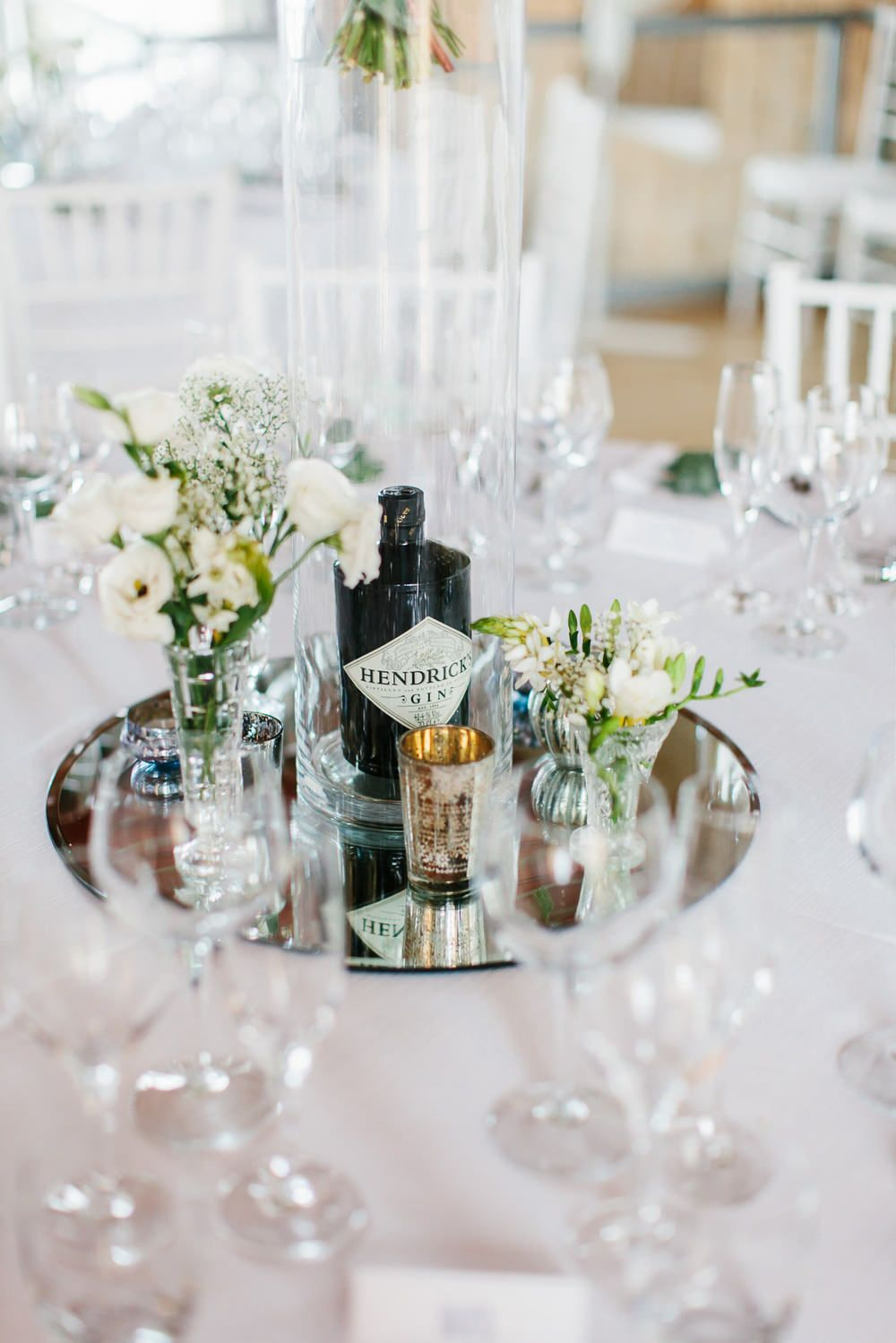 We really like the mirror/glass centre piece with a mix of silver /glass  tea light holders, candles and small flower vases.
