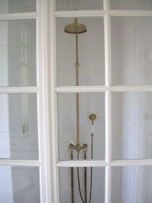 Vintage style shower fixtures + a wall of windows   Country Living ...