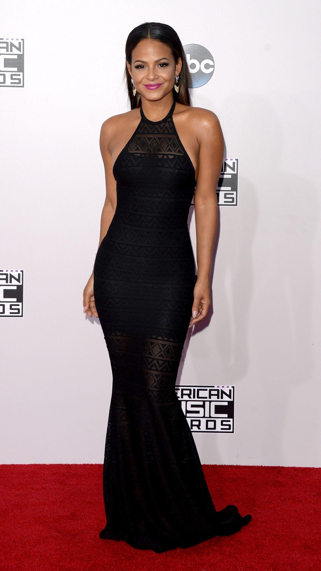 ef081d7c6d Who  Christina Milian Wore  A slinky black halter dress Where  2014  American Music