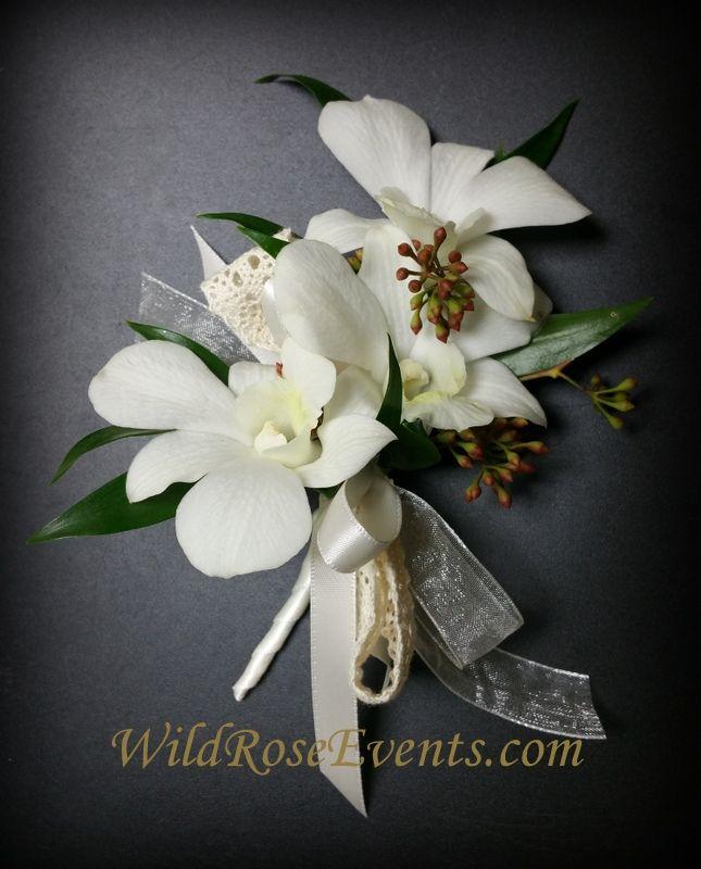 White dendrobium and Eucalyptus corsage.  #WildRoseEvents #corsage #weddingflowers