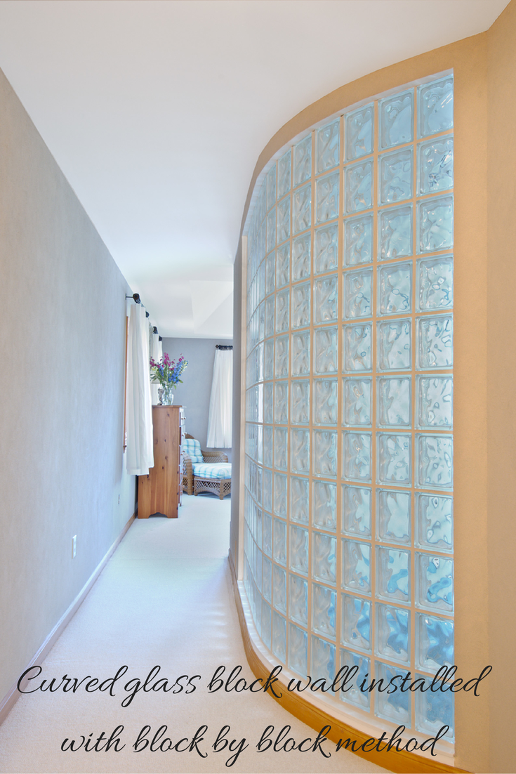 Curved glass block bedroom wall using block by block installation process