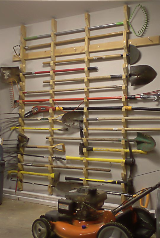 Garden tool rack garden tool storage tool storage and for Garden tool storage ideas