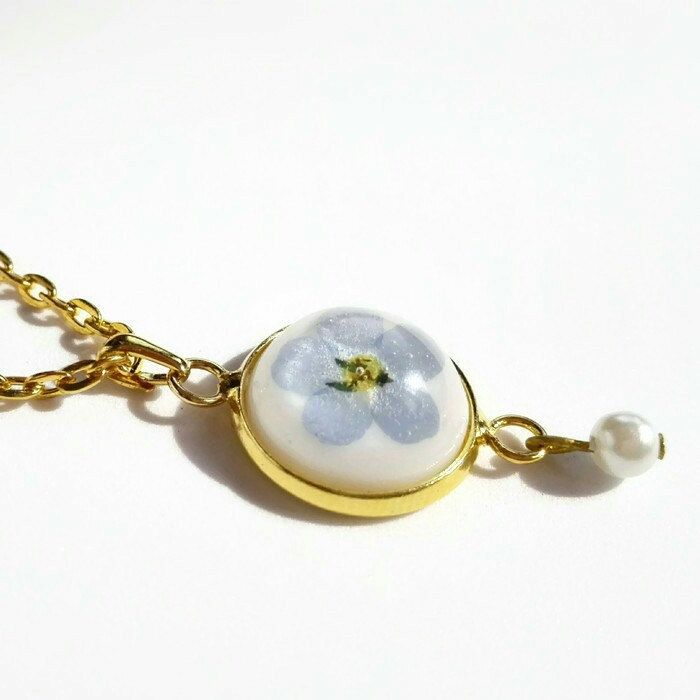 Real forget me not treasure for your bridesmaid! Sweet resin and gold necklace