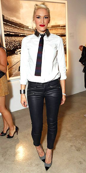 GWEN STEFANI  Going literal with the menswear trend – and looking surprisingly sexy while doing so – Gwen adds a striped tie to her button-up, then completes the look with tough cuffs, zippered leather Rag & Bone exclusive for Intermix pants and pointed heels at the Exposure 2 Photo Exhibit in L.A.