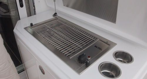 Cruisers Yachts 41 Cantius: I would consider designing the space below the grill for a carry-on cooler which you can fill at home with steaks and burgers.