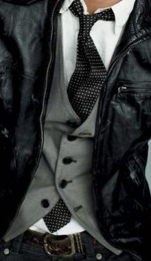 Leather jacket with vest & dotted tie. Very nice.