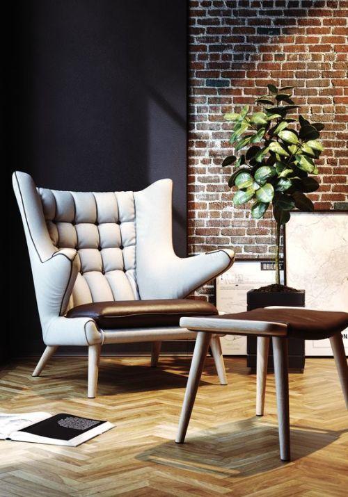 Gemütliche sessel wohnzimmer  Gemütlicher Sessel im Wohnzimmer mit Backsteinwand ...