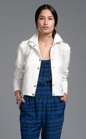 White perforated jacket, check, blue patterned jumper, check,  Tracy Reese love, triple check.
