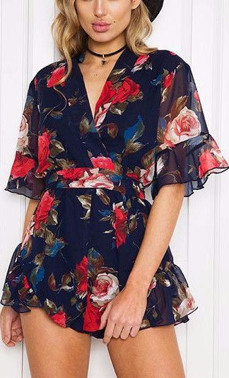Short sleeved sheer chiffon ruffle mini floral print playsuit with choker tie.  Details    Polyester  Chiffon  Imported  Delicate Cold Wash  Fits True To Size