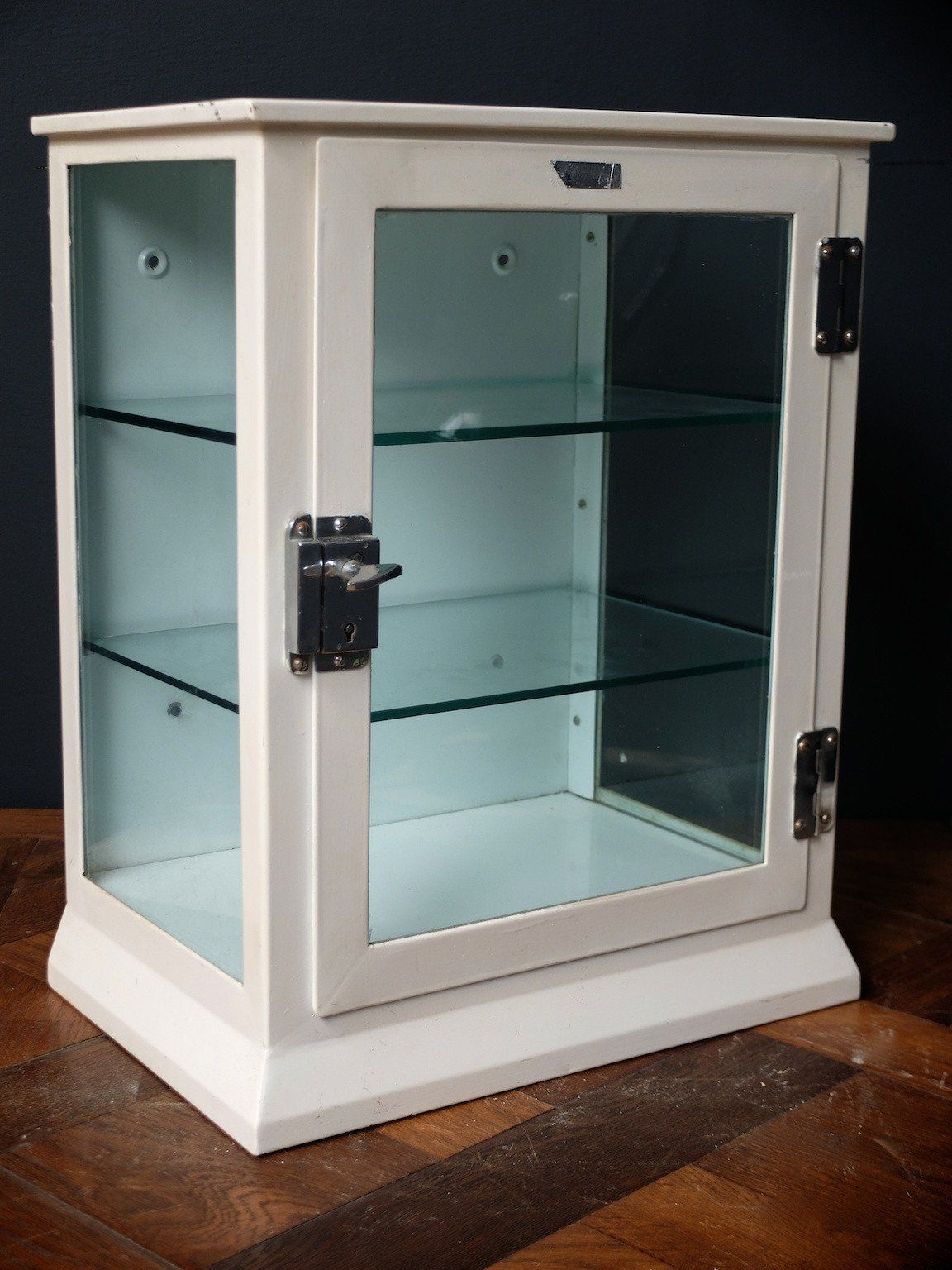 A glazed steel medical cabinet. Can be wall or worktop mounted ...