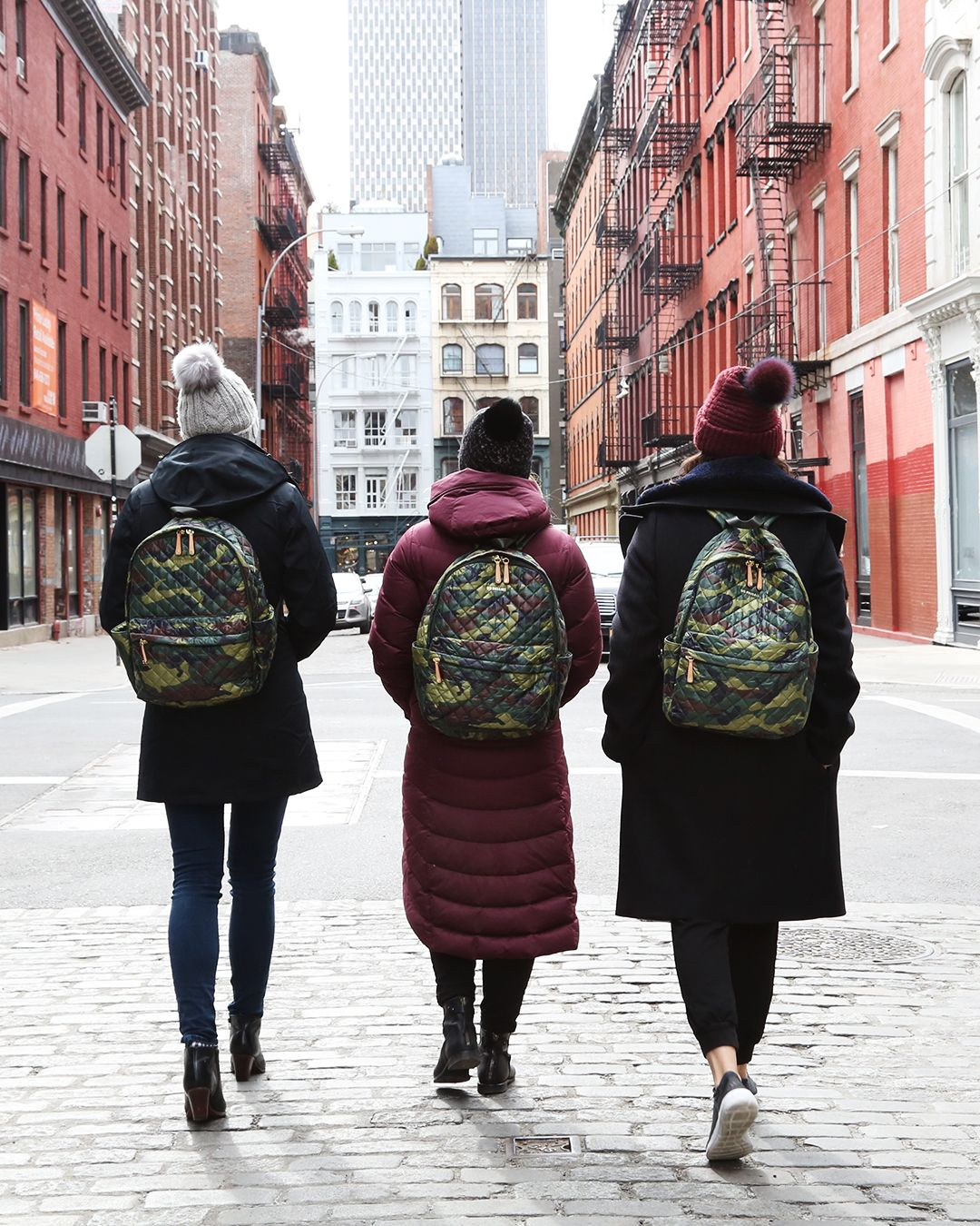 a82b4723a9c01f MZ Wallace Camo Print Oxford Nylon Metro Backpacks all in a row walking  down the middle of Crosby Street