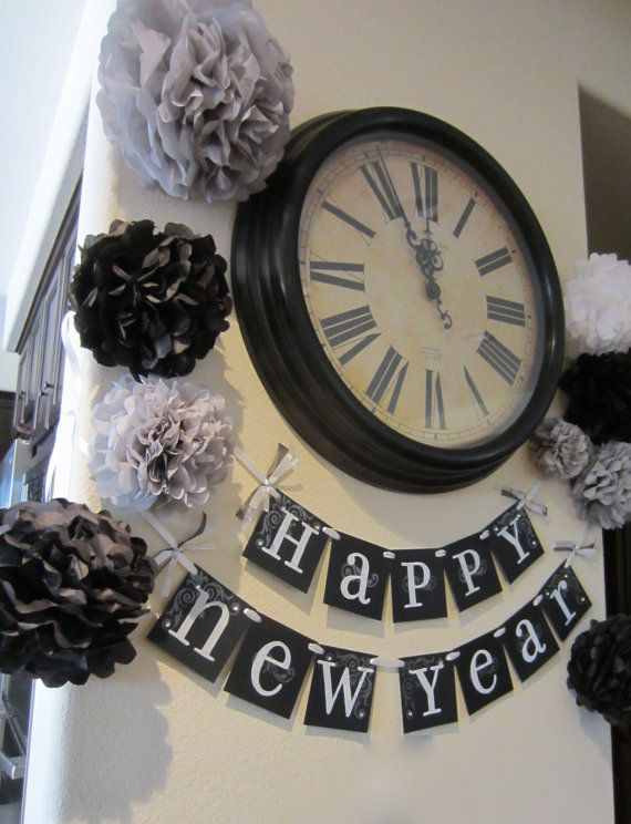 what a great idea for new years just hang a banner sign near a clock in your house and add the tissue paper flowers