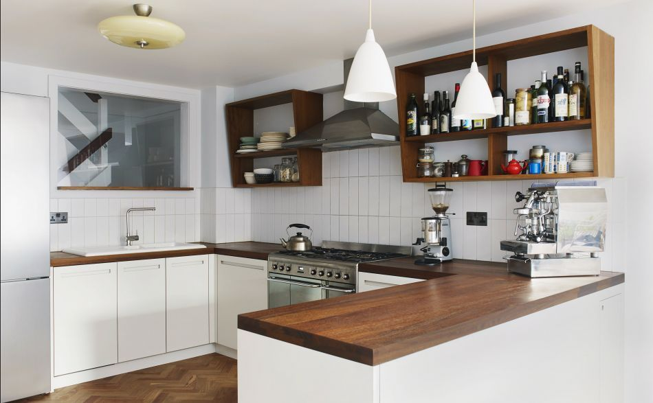 modern kitchen with white cabinets and dark wooden worktop - wohnzimmer modern und gemutlich