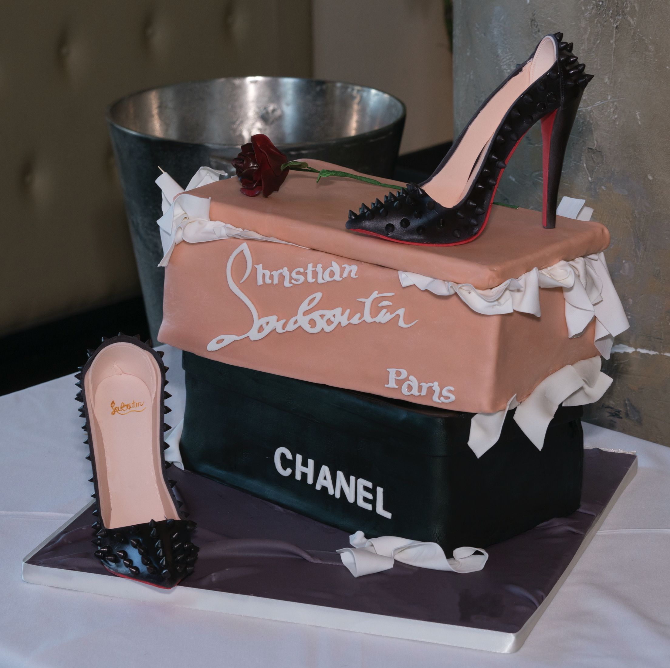 Cake shoe boxes with sugar Louboutin shoes . Gumpaste tissue paper