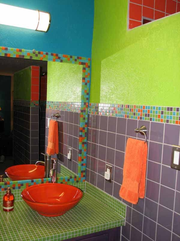 the purple green and orange in this bathroom are the