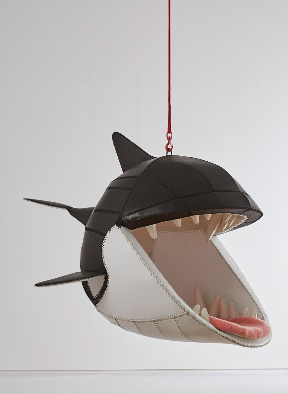 Ad these hanging chairs let you sit in the mouths of animals 03