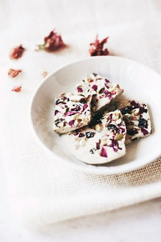 Vegan White Chocolate Flower Bark | Free People Handmade in Nantucket, Massachusetts, this white chocolate flower bark is crafted from a blend of organic ingredients and wild Nantucket rose petals for a floral twist on a delicious treat.