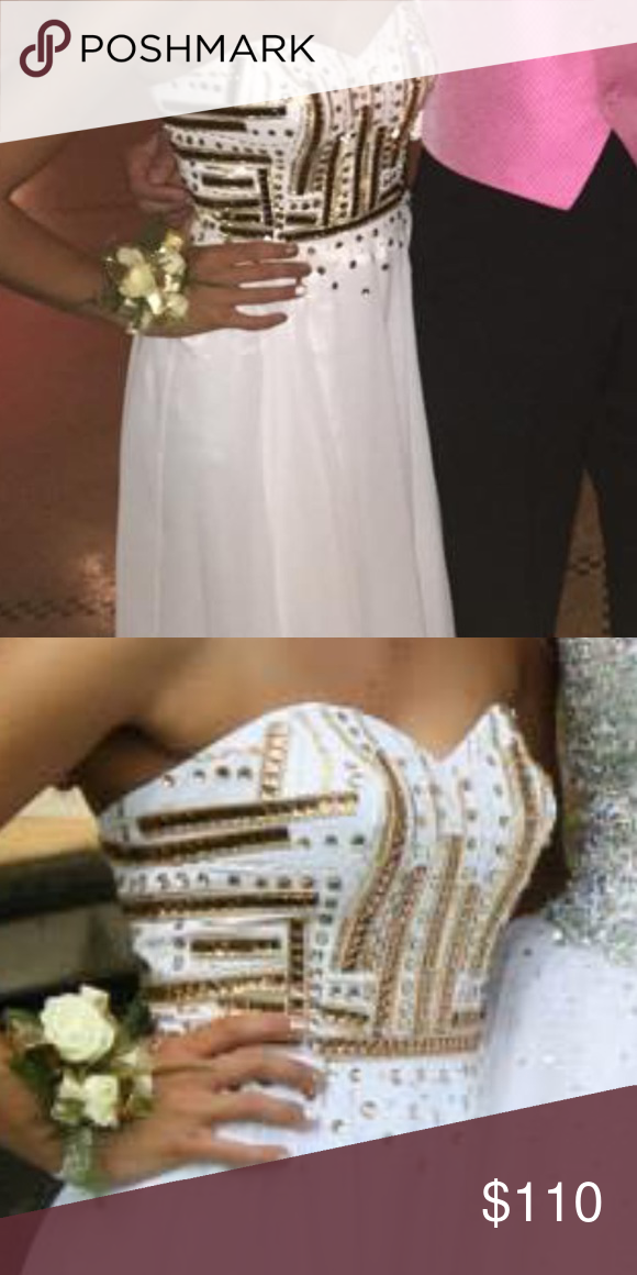 Prom dress Gorgeous, long, white dress with unique gold beading on top . Size 2, but was fitted. I am 5'4 and got the bottom trimmed. Worn once. Willing to negotiate price Dresses Prom