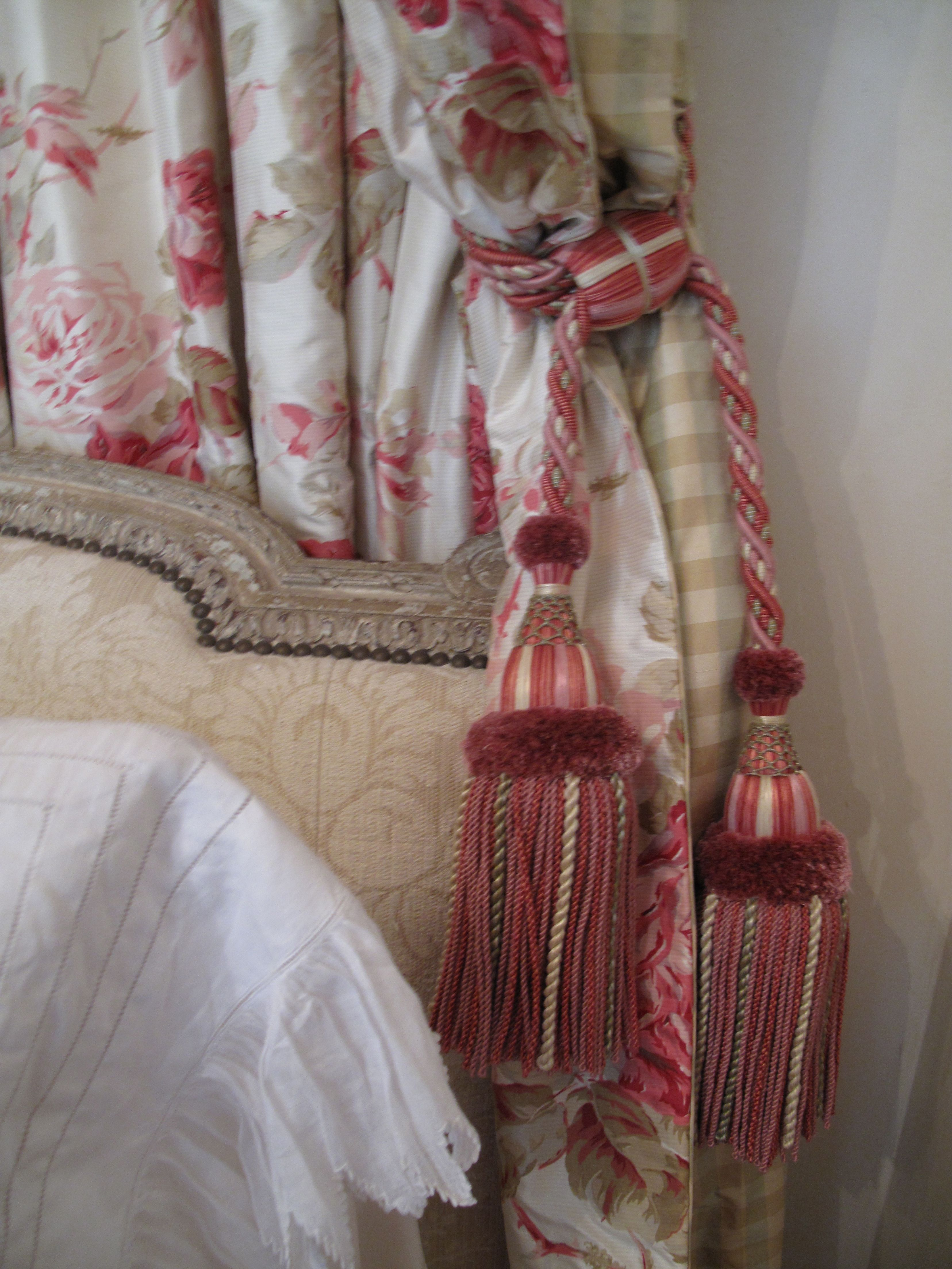 Antique upholsterd bed with custom draperies and tassels. www.lindafloyd.com