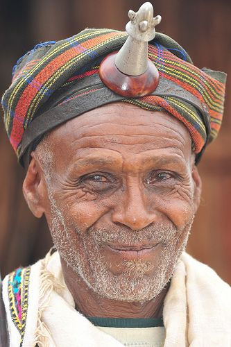 Africa   Borana chief. The Borana live in south Ethiopia and mostly follow their ancient way of living. The gaddaa system is some kind of generation structure, which changes every 7-8 years, the chief of gaddaa is widely respected, even after his gaddaa is finished, he can still keep his regalia: the kalacha (fallus like ornament he is wearing on the forehead), the uroro (stick) and the licha (to whip his wives and whoever needs it according to him).   © Geert Henau