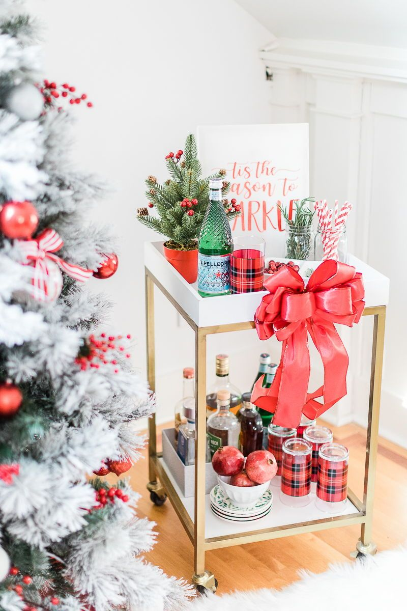 It's beginning to look a lot like cocktails! In today's post, popular lifestyle blogger Stephanie Ziajka shares her top Christmas bar cart styling tips-- including her bar cart staples (liquor, bar tools, the special edition diamond Pellegrino bottle, etc) and a handful of simple and affordable holiday bar cart decor ideas. Click through to read the full post on Diary of a Debutante! #christmas #holidayentertaining #barcart