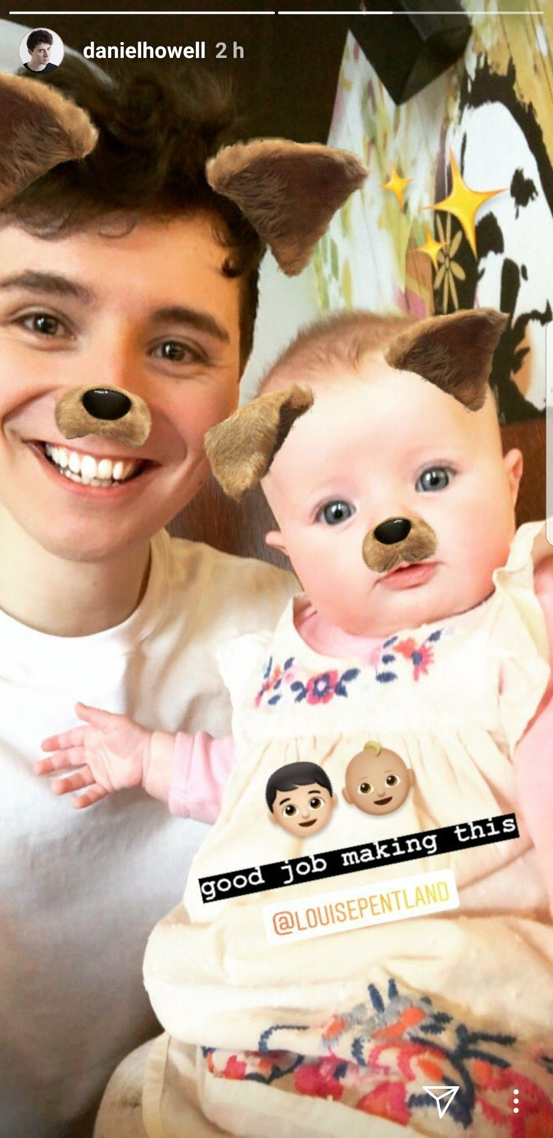 Dan Howell Holding A Baby