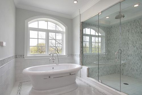 A Beautiful And Stylish White And Grey Bathroom With Double Shower Wi White Master Bathroom Modern Master Bathroom Remodel Bathroom Remodel Master
