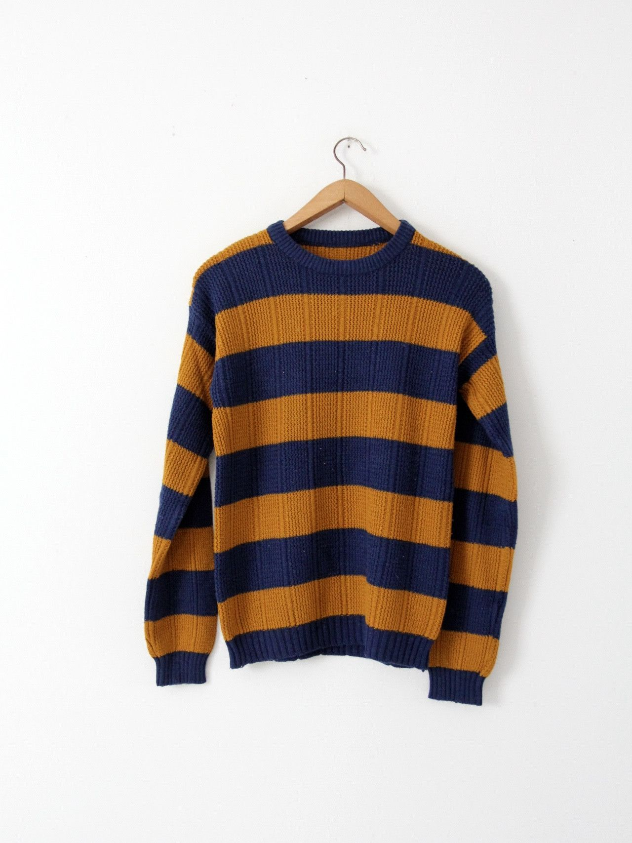 2fc9ec2706f84 A 1970s vintage striped knit sweater. The ribbed knit crew neck sweater  features bold blue and gold horizontal stripes. - blue and gold - acrylic  or cotton ...