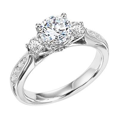 The Classic Three Stone Engagement Ring with Channel Set Side