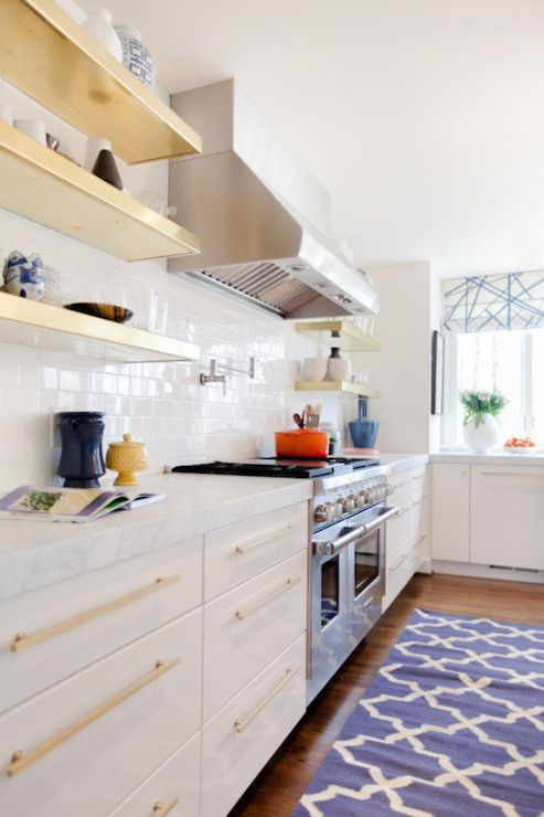 Amazing Kitchen Features Stacked Gold Floating Shelves In Lieu Of Upper Cabinets And White Frameless Accented With Br Pulls Paired Carrara