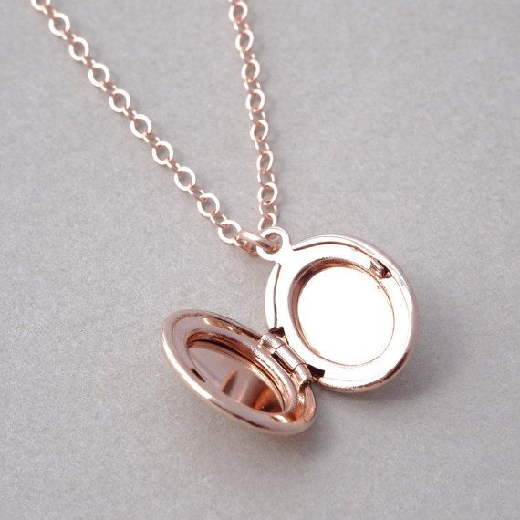 ✦ Mobile shoppers < swipe > to see all photos ✦  This small polished 18K rose gold plated (over brass) oval locket hangs from a sparkly American made 16K rose gold filled cable chain. The chain, spring ring clasp and findings are made in the USA and are of truly exceptional quality and strength. Longer chain lengths available, please see drop down menu. This necklace will arrive beautifully wrapped, ready for gift giving. • 16K rose gold filled cable chain, clasp and findings. • 18K rose…