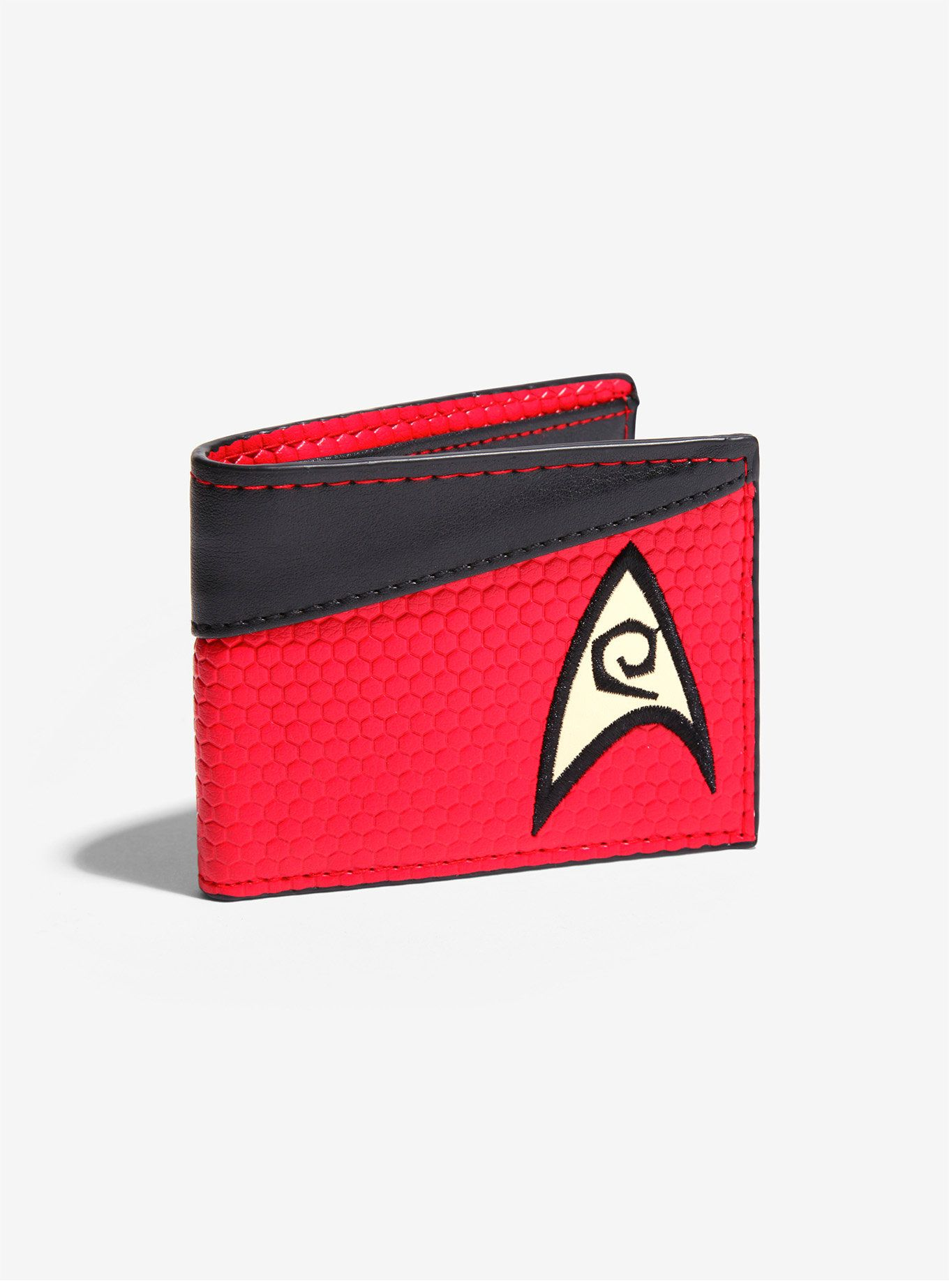 <p>Where no man has gone before… or whatever. Keep your cash and coins safe with this <i><em>Star Trek</i></em> bi-fold wallet featuring a Star Fleet Engineering Corps logo, faux leather detail and a clear ID display.</p>  <ul> <li>3 credit card slots</li> <li>Imported</li> </ul>