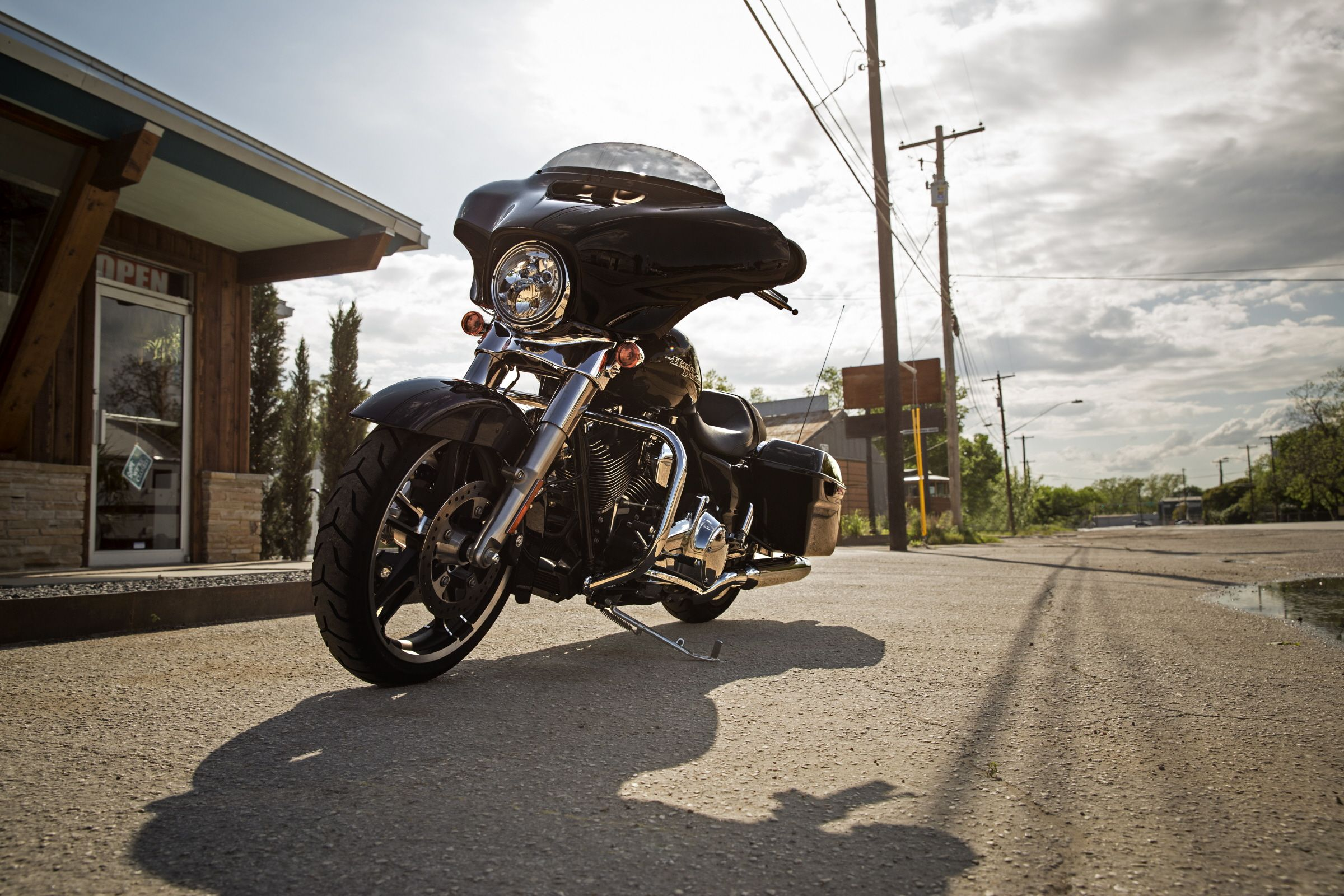 From the tip of its sleek Project RUSHMORE front fender to the tip of its chrome exhaust, the Street Glide defines the state of the art in stripped down bagger style. | 2016 Harley-Davidson Street Glide