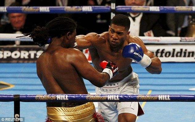 Anthony Joshua (right) defeated Charles Martin to take the IBF title stripped from Fury