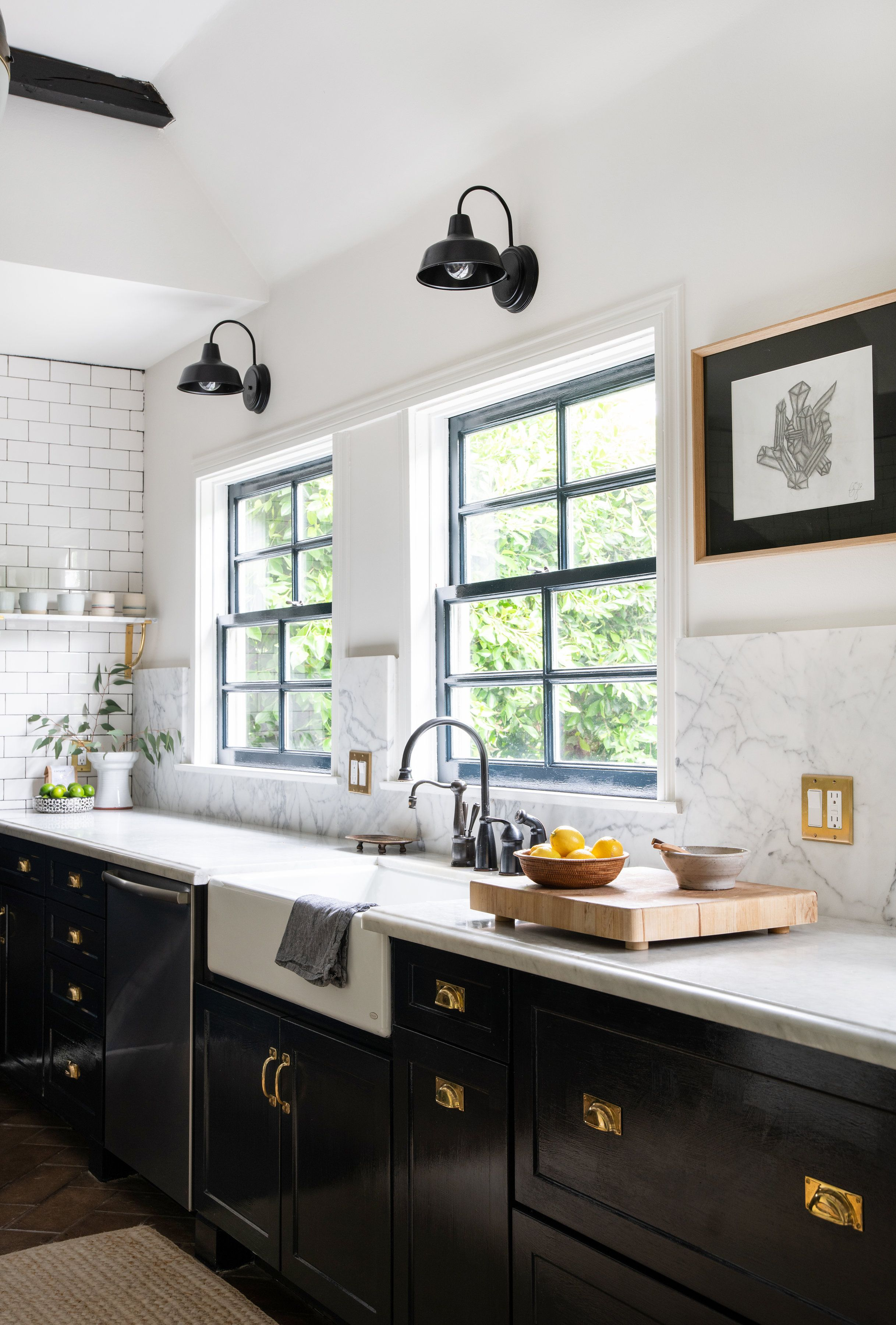 kitchen with navy cabinets gold hardware and farmhouse lights in hancock park los angeles ca on kitchen cabinets gold hardware id=87564